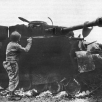 American_Soldier_Inspecting_Wrecked_German_Tank