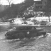 CAR_BEARING_GENERAL_BRADLEY_FORDS_A_BELGIAN_RIVER