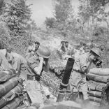 604px-British_4_2_inch_mortar_fining_Cassino_12-05-1944_IWM_NA_14735